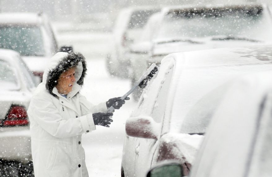 Helen Earley cleans off her car in the parking lot of Hawkins Market in Ashland, Ohio Wednesday, Dec. 26, 2012 after buying groceries. (AP Photo/Ashland Times-Gazette, Tom E. Puskar)