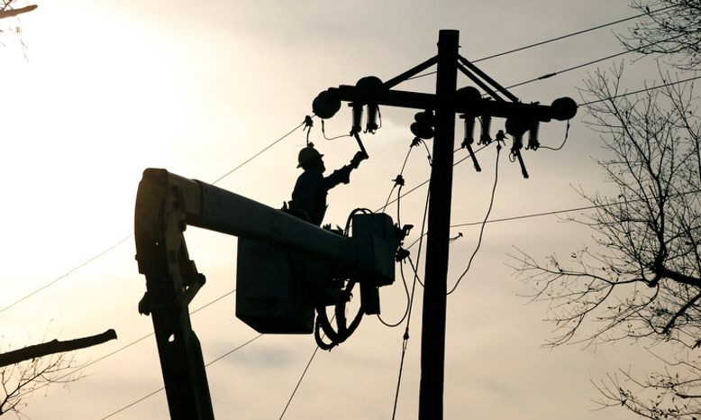 A Coast Electric Power Association lineman grounds a line on a replacement pole in McNeill, Miss., Wednesday, Dec. 26, 2012. The Christmas day storms downed both telephone and electric power lines and poles throughout the state in addition to extensive private property damage.  (AP Photo/Rogelio V. Solis)