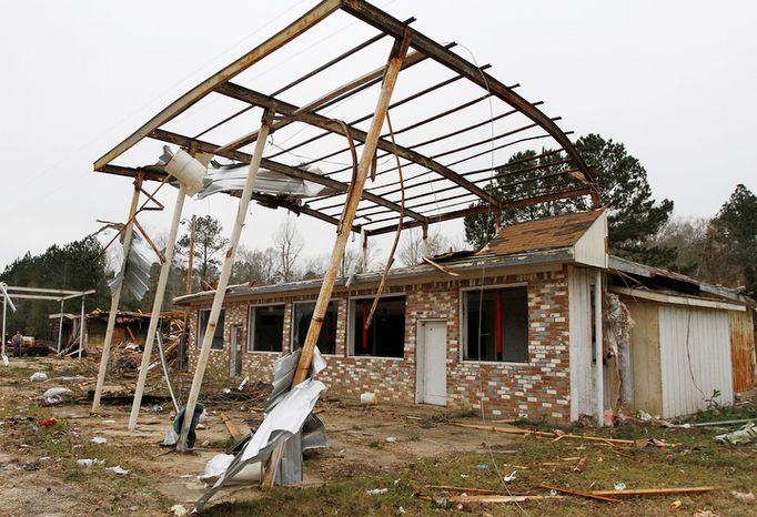 A storm-ravaged store and debris sit in Monticello, Miss. on Wednesday, Dec. 26, 2012.  More than 25 people were injured and at least 70 homes were damaged in Mississippi by the severe storms that pushed across the South on Christmas Day, authorities said Wednesday. (AP Photo/The Enterprise-Journal, Philip Hall)