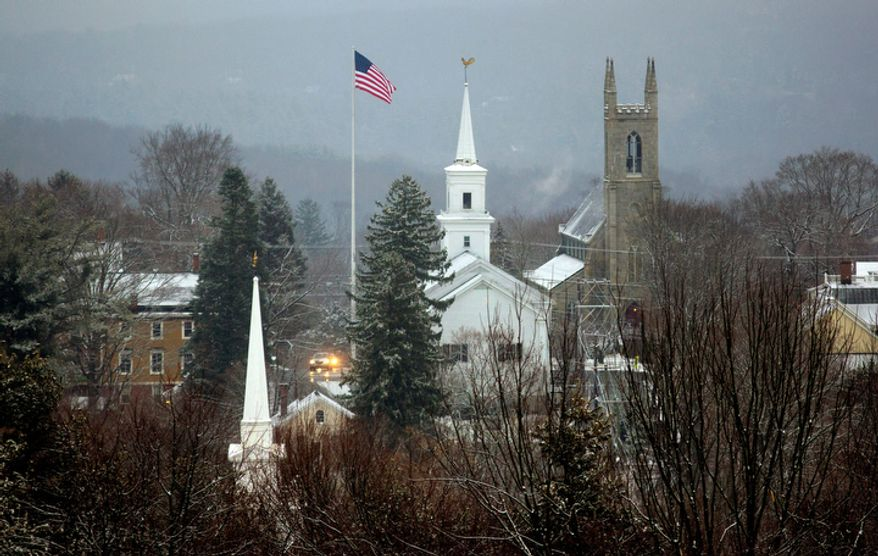 A light coating of snow blankets Newtown, Conn. Tuesday, Dec. 25, 2012. The town is dealing with the aftermath following gunman Adam Lanza's shooting spree at the Sandy Hook Elementary School on Friday, Dec. 14, that killed 26, including 20 children, before he killed himself.  (AP Photo/Craig Ruttle)