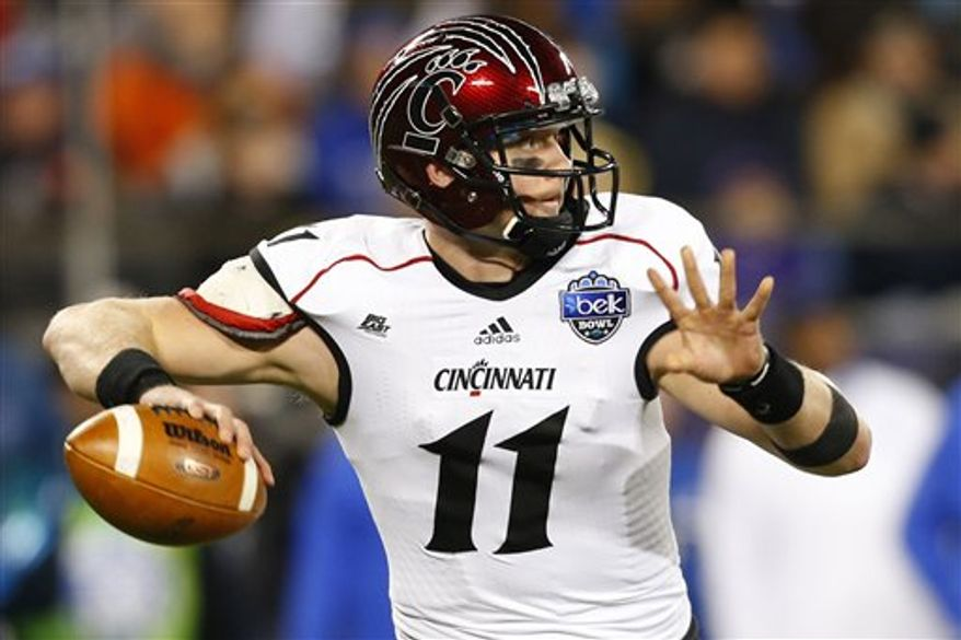 Cincinnati's Brendon Kay (11) looks to pass against Duke during the first half of the Belk Bowl NCAA college football game in Charlotte, N.C., Thursday, Dec. 27, 2012. (AP Photo/Chuck Burton)