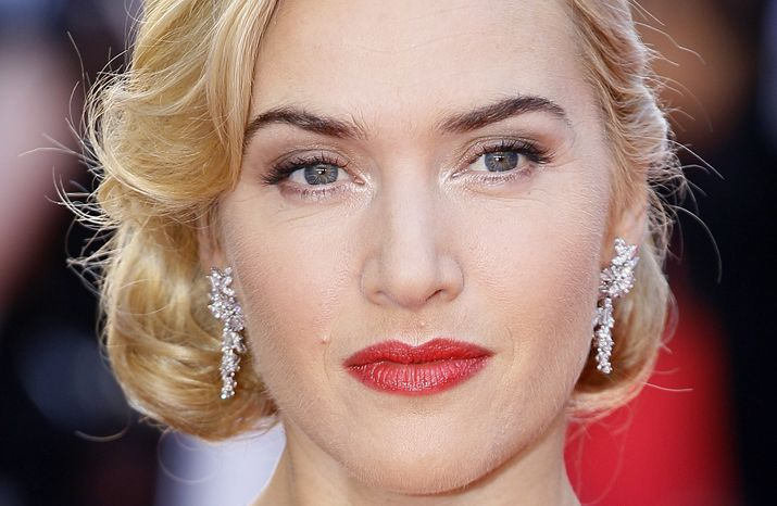 """British actress Kate Winslet arrives for the world premiere of the 3-D version of the film """"Titanic"""" at the Royal Albert Hall in London on Tuesday, March 27, 2012. (AP Photo/Alastair Grant)"""