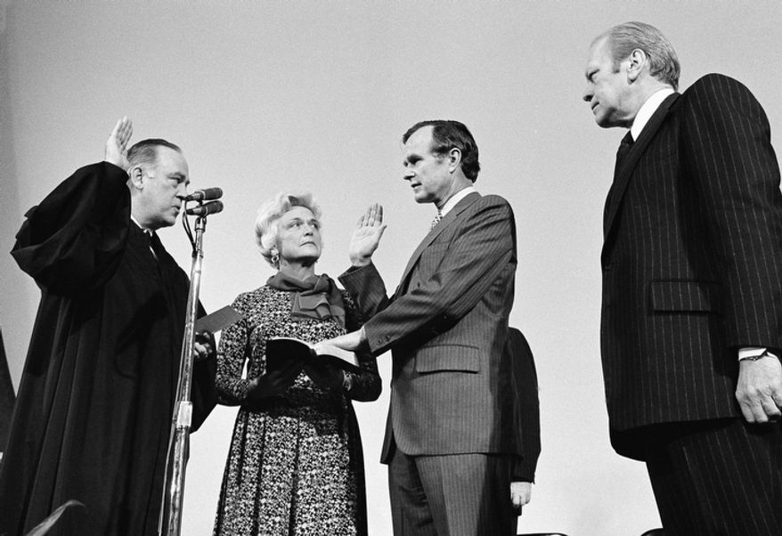 George Bush is sworn in as new director of the Central Intelligence Agency by Supreme Court Associate Justice Potter Stewart, left, as Mrs Barbara Bush and President Gerald Ford, at right, look on at CIA headquarters in Langley, Va., January 30, 1976. Bush succeeds William Colby who retired. (AP Photo)