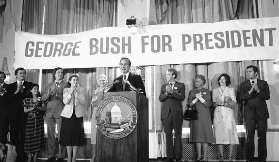 George Bush beams as some of his family members applaud at the National Press Club in Washington on Tuesday, May 1, 1979 where he formally announced his candidacy for the Republican presidential nomination. From left are: John E., a son; Columba, a daughter-in-law; Marvin, a son; Dorothy, a daughter; Mrs. Barbara Bush, his wife; and Bush. (AP Photo/Taylor)