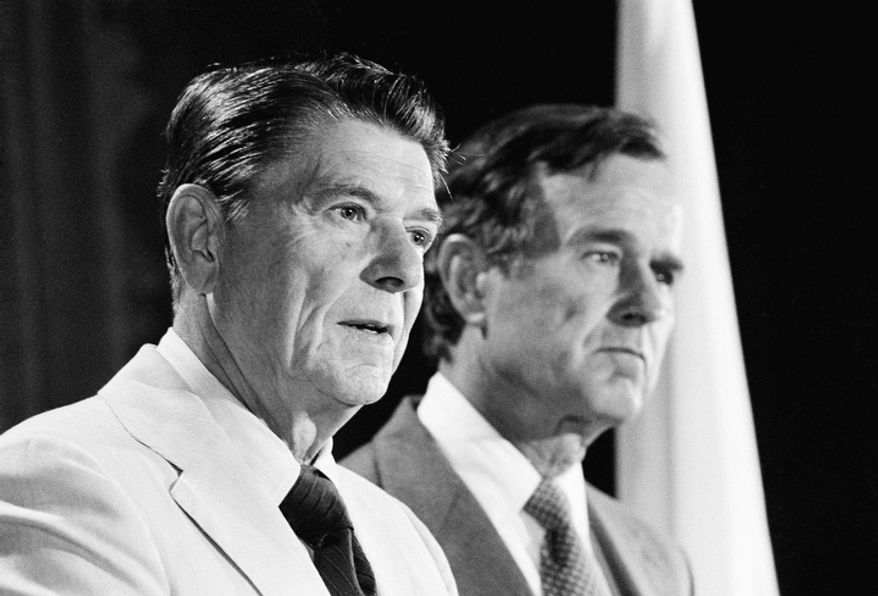 ** FILE ** Republican candidate for President Ronald Reagan, left, and his running mate George  H.W. Bush answer questions during a press conference Friday, July 26, 1980. (AP Photo/Wally Fong)
