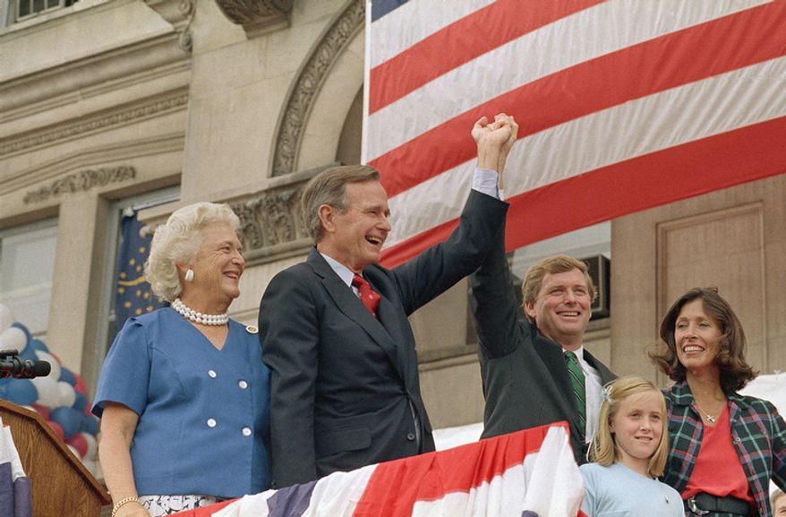 Republican running mates George H. W. Bush, center, and Sen. Dan Quayle, third from right, begin the long campaign trial at a rally in Quayle's hometown, Friday, Aug. 20, 1988 Huntington, Ind. Bush's wife, Barbara Bush , left, Quayle's wife, Marilyn Quayle, right, and daughter Corinne Quayle, joined them at the rally. (AP Photo/Scott Applewhite)