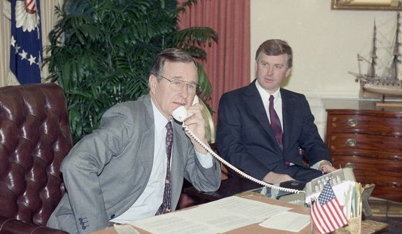 Pres. George H. W. Bush, left, speaks to the orbiting Columbia astronauts with Vice Pres. Dan Quayle from the Oval Office, Thursday, Jan. 18, 1989, Washington, D.C. (AP Photo/Ron Edmonds)