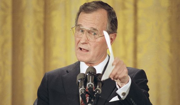 Pres. George H. W. Bush makes a point during first presidential prime time televised news conference in the East Room of the White House, Thursday, June 9, 1989, Washington, D.C. Bush told reporters that the United States cannot return to totally normal relations with china unless that government recognizes the validity of democracy forces. (AP Photo/Ron Edmonds)