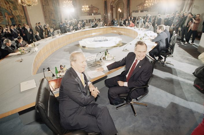 U.S. President George H. Bush sits with Secretary of State James Baker, left, at the Round Table as the summit talks begin with the other leaders of the G-7 countries in Munich, Germany, Tuesday, July 7, 1992. (AP Photo/Scott Applewhite)