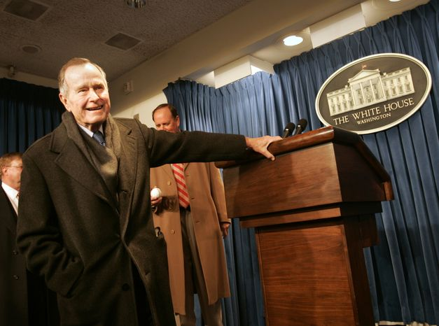 Former President George  H. W.  Bush talks to the media during an impromptu visit of the Brady Press Briefing room at the White House, Saturday, Jan. 22, 2005 in Washington. (AP Photo/Lawrence Jackson)