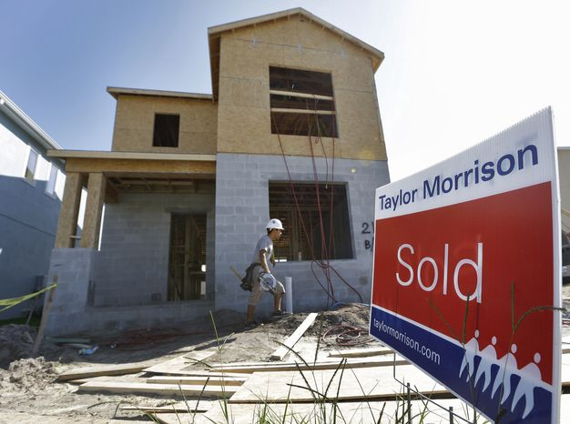 """A new home under construction already has a """"sold"""" sign out in front on Wednesday, Sept. 26, 2012, in Riverview, Fla. (AP Photo/Chris O'Meara)"""