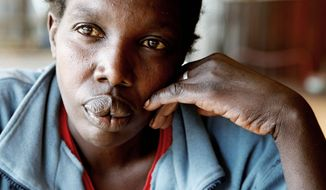 """Maimouna Awuor, 44, an impoverished mother of four who gave birth to her fifth child in October 2010, couldn't pay the $60 hospital bill, and was held along with many other women and their infants. """"They stay there until they pay,"""" said the hospital's administrator. """"If you don't pay, the hospital will collapse."""" (Associated Press)"""