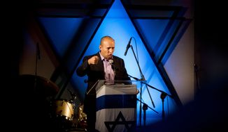 Naftali Bennett, head of the Jewish Home party, speaks in Ashdod, Israel, on Wednesday, Dec. 26, 2012. Mr. Bennett, the charismatic new leader of Israel's Jewish religious right, is siphoning a large chunk of votes from the prime minister's party, according to polls ahead of Jan. 22 election. (AP Photo/Ariel Schalit)