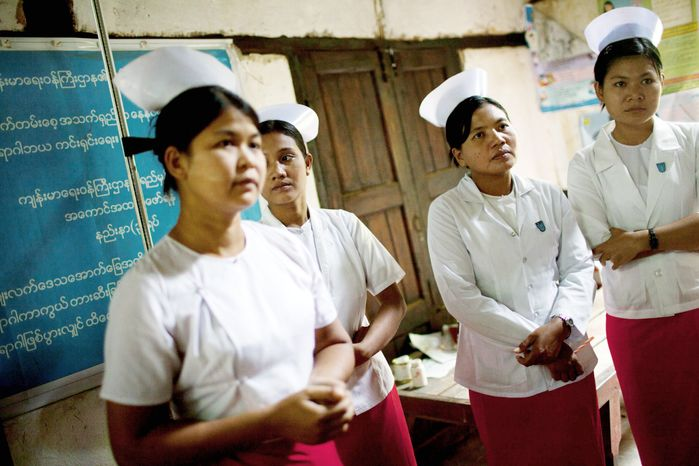 Nurses, who are also midwives, gather at a village health room for a briefing given by a UNICEF child-nutrition specialist in Zee Phyu Kwin, in the Irrawaddy Delta of Myanmar. Myanmar spent less than $1 per person on health in 2008, minus donor money, and ranks among the lowest countries in nearly every category of health care funding. Now, with the dramatic change that has given Myanmar an elected government, there are hopes for improvement. (Associated Press)