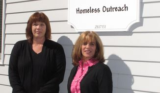 ** FILE ** In this Oct. 11, 2012, photo, Tracey Lutz, left, executive director of the Maureen's Haven homeless outreach program, and Joann Piche, chairwoman of the board of directors, stand outside the Long Island charity's headquarters in Riverhead, N.Y. In one of the richest communities on the tony end of Long Island, a group of churches work together to provide shelter for 50-60 homeless people each night. (AP Photo/Frank Eltman)