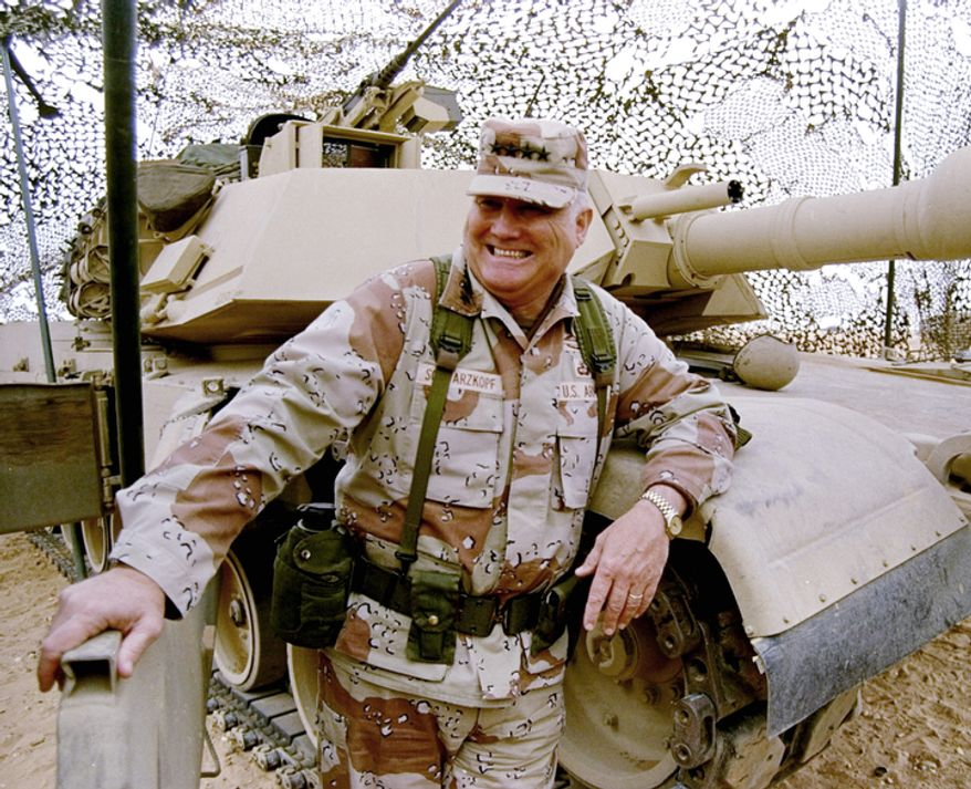 **FILE** Gen. H. Norman Schwarzkopf stands at ease with his tank troops during Operation Desert Storm in Saudi Arabia on Jan. 12, 1991. (Associated Press)