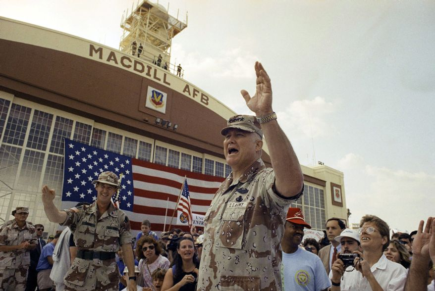 **FILE** Gen. H. Norman Schwarzkopf waves to the crowd after a military band played a song in his honor during welcome-home ceremonies at MacDill Air Force Base in Tampa, Fla., on April 22, 1991. (Associated Press)
