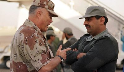 **FILE** Gen. Norman Schwarzkopf (left), commander of U.S. forces in the Gulf, confers with Saudi Arabian Lt. Gen. Khalid Bin Sultan, commander of multinational forces in the area, in Riyadh on Dec. 19, 1990. (Associated Press)