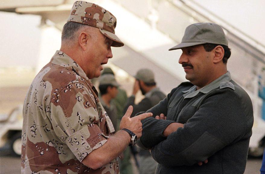 **FILE** Gen. Norman Schwarzkopf (left), commander of U.S. forces in the Gulf, confers with Saudi Arabian Lt. Gen. Khalid Bin Sultan, commander of multinational forces in the area, in Riyadh on Dec. 19, 1990. (Associated Press)