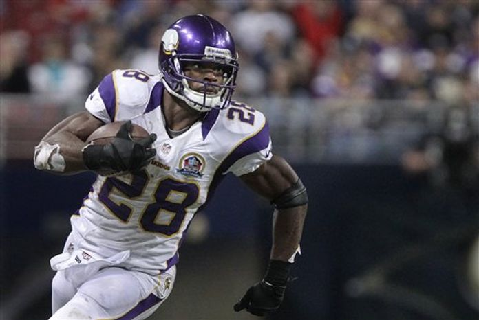 ** FILE ** In this Dec. 16, 2012, photo, Minnesota Vikings running back Adrian Peterson runs during the third quarter of an NFL game against the St. Louis Rams in St. Louis. Peterson was selected to the Pro Bowl on Wednesday, Dec. 26, 2012. (AP Photo/Seth Perlman, File)