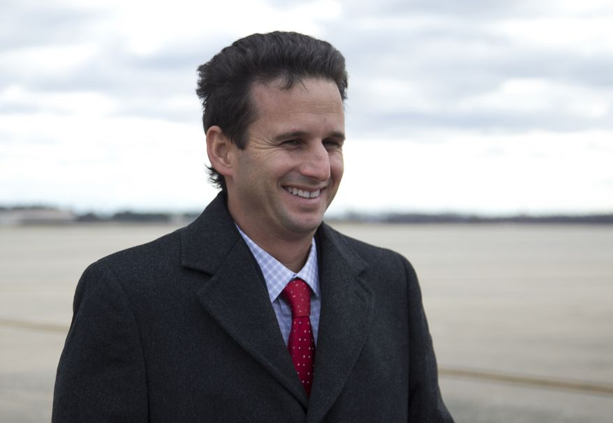 ** FILE ** Hawaii's newest senator, Brian Schatz, who was the state's lieutenant governor, smiles as he talks with reporters on the apron after deplaning from Air Force One on Thursday, Dec. 27, 2012, at Andrews Air Force Base in suburban Washington. Hawaii Gov. Neil Abercrombie appointed Mr. Schatz to the post a day earlier to replace the late Sen. Daniel K. Inouye. (AP Photo/Carolyn Kaster)