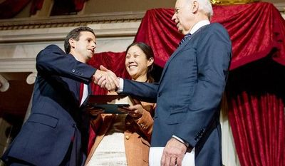 Linda Schatz, center, watches as her husband, Brian Emanuel Schatz (D-Hawaii), re-enacts his swearing in ceremony with Vice President Joe Biden inside the old Senate Chamber at the U.S. Capitol Building, Washington, D.C., Thursday, December 27, 2012. Schatz, who was the Lt. Gov. for Hawaii was selected by Hawaii Gov. Neil Abercrombie to the U.S. Senate seat left vacant by the late Daniel K. Inouye. (Andrew Harnik/The Washington Times)