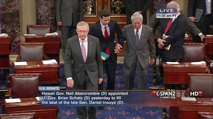 This handout video frame grab image provided by C-SPAN2 shows Senate Majority Leader Harry Reid of Nev., left leading Hawaii's newest Sen. Brian Schatz, center, and retiring Hawaii Sen. Daniel Akaka, walking on the Senate floor on Capitol Hill in Washington, Dec. 27, 2012, where Vice President Joe Biden administered the Senate oath to Schatz. Schatz replaces Sen. Daniel Inouye, D-Hawaii who died last week. Akaka is retiring and will be succeeded by Rep. Mazie Hirono who was elected in November. (AP Photo/C-SPAN2)