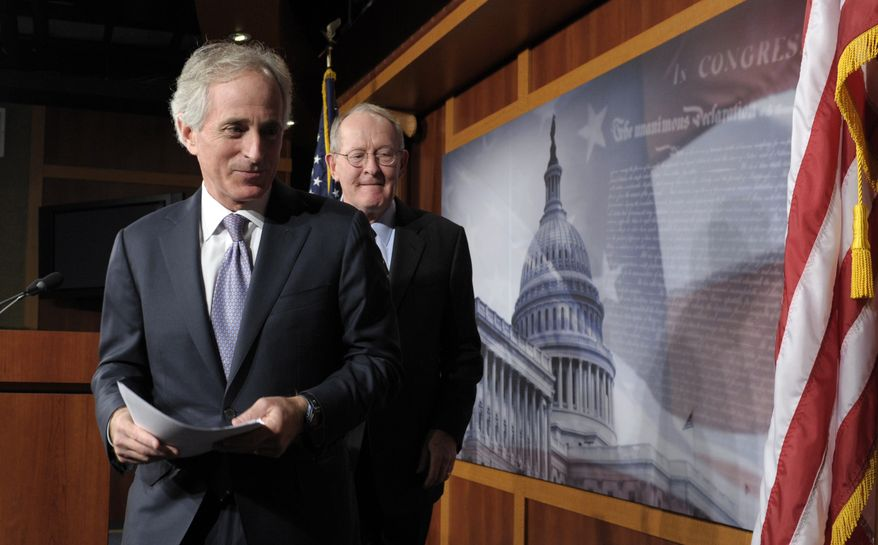 Republican Sens. Bob Corker (left) and Lamar Alexander, both of Tennessee, leave a news conference Dec. 28, 2012, on Capitol Hill in Washington where they discuss the fiscal cliff. (Associated Press)