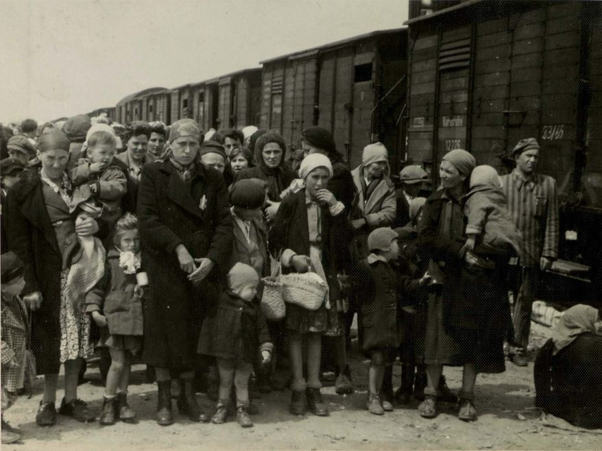 Jewish women and children deported from Hungary, separated from the men, line up for selection on the selection platform at Auschwitz camp in Birkenau, Poland, in May 1944. (Associated Press/Yad Vashem Photo Archives)