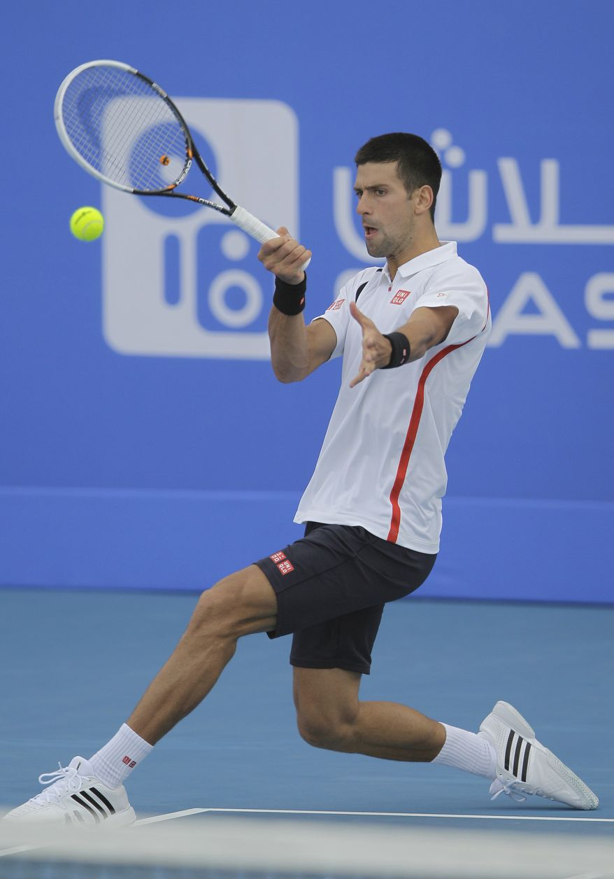 Novak Djokovic returns the ball to David Ferrer during the second day of the Mubadala Tennis Championship in Abu Dhabi, United Arab Emirates, on Dec. 28, 2012. (Associated Press)