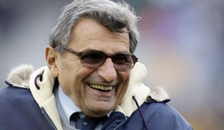 **FILE** Penn State coach Joe Paterno smiles as he walks the field before an NCAA college football game against Minnesota in State College, Pa., on Oct. 17, 2009. (Associated Press)