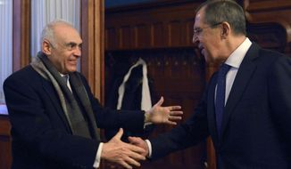 Russian Foreign Minister Sergey Lavrov (right) welcomes his Egyptian counterpart Mohamed Kamel Amr prior to a meeting in Moscow on Dec. 28, 2012. (Associated Press)