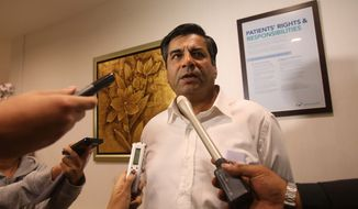 Indian High Commissioner to Singapore, T.C.A. Raghavan speaks to reporters — about the death of a young Indian woman who was gang-raped — at Mount Elizabeth Hospital late on Saturday, Dec. 29, 2012, in Singapore. (AP Photo/Wong Maye-E)