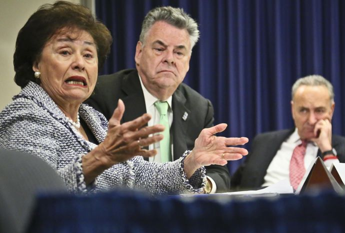 ** FILE ** Congressman Peter King, center, and Sen. Chuck Schumer, right, listens as Congresswoman Nita Lowey speaks during a news conference, Friday, Dec. 14, 2012 in New York. (AP Photo/Bebeto Matthews)