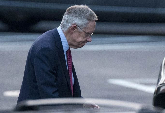 Senate Majority Leader Harry Reid of Nevada leaves the White House in Washington, Friday, Dec. 28, 2012, after a closed-door meeting between President Barack Obama and congressional leaders to negotiate the framework for a deal on the fiscal cliff. (AP Photo/ Evan Vucci)