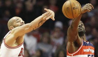 Washington Wizards center Emeka Okafor, right, and Chicago Bulls forward Carlos Boozer battle for a rebound during the first half of an NBA basketball game in Chicago on Saturday, Dec. 29, 2012. (AP Photo/Nam Y. Huh)