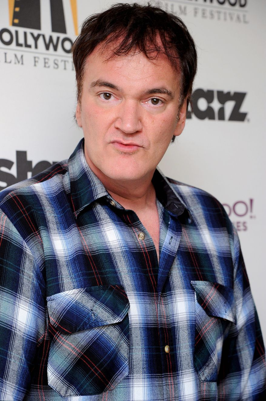 Quentin Tarantino poses backstage at the 15th Annual Hollywood Film Awards Gala on Monday, Oct. 24, 2011 in Beverly Hills, Calif. (AP Photo/Kristian Dowling)