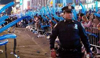 ** FILE ** The New York Police Department assigned thousands of extra patrols to Times Square last year on New Year's Eve to control the crowd and watch for any signs of trouble. (Associated Press)