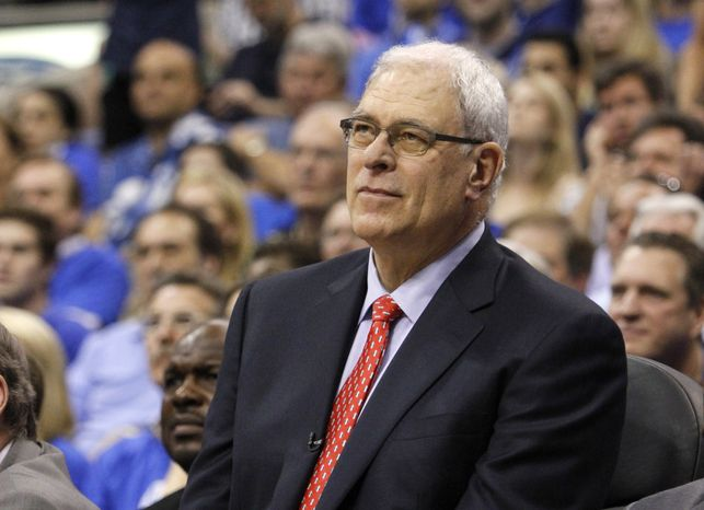 Phil Jackson could be atop Nets owner Mikhail Prokhorov's coaching list after Avery Johnson was fired with the team 14-14. (Associated Press)