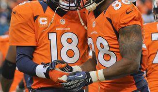 Denver Broncos quarterback Peyton Manning (18) congratulates Denver Broncos wide receiver Demaryius Thomas (88) after a touchdown in the third quarter of an NFL football game against the Kansas City Chiefs, Sunday, Dec. 30, 2012, in Denver. (AP Photo/Jack Dempsey)