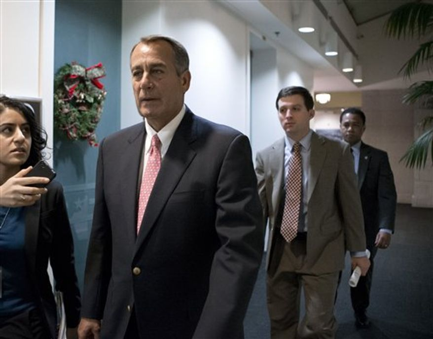 "Speaker of the House John Boehner, Ohio Republican, walks to a closed-door GOP caucus as Congress meets to negotiate a legislative path to avoid the so-called ""fiscal cliff"" of automatic tax increases and deep spending cuts that could kick in Jan. 1., at the Capitol, Sunday, Dec. 30, 2012. (AP Photo/J. Scott Applewhite)"