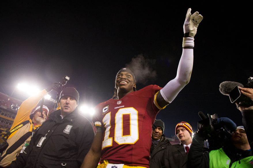 Washington Redskins quarterback Robert Griffin III (10) points to the stands after the Washington Redskins defeat the Dallas Cowboys 28-18 to become the NFC East Champions at FedEx Field, Landover, Md., Sunday, December 30, 2012. (Andrew Harnik/The Washington Times)