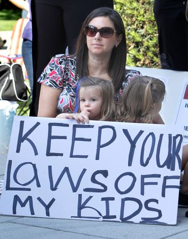 One California law that takes effect Tuesday has drawn opposition. In September, parents and their children rallied outside the Capitol to protest legislation requiring parents to get waivers saying they have received information about the benefits and risk of immunization. (Associated Press)