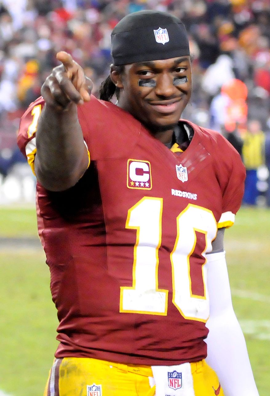 Quarterback Robert Griffin III, who scored a rushing touchdown on Sunday night, called the division-clinching victory over the rival Cowboys the greatest win of his life. (Preston Keres/Special to The Washington Times)