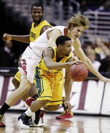 George Mason's Corey Edwards, front, moves the ball as Maryland's Jake Layman, center, defends during the first half of an NCAA college basketball game at the BB&T Classic in Washington, Sunday, Dec. 2, 2012. Maryland won 69-62. (AP Photo/Luis M. Alvarez)