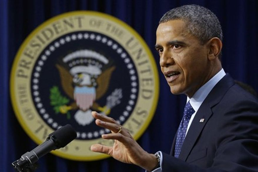 """President Obama gestures as he speaks about the fiscal cliff, Monday, Dec. 31, 2012, in the South Court Auditorium at the White House in Washington. The president said it appears that an agreement to avoid the fiscal cliff is """"in sight,"""" but says it's not yet complete and work continues. (AP Photo/Charles Dharapak)"""