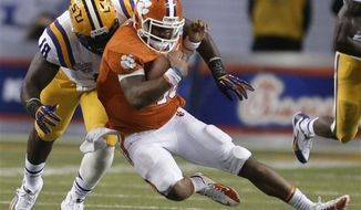 Clemson quarterback Tajh Boyd (10) is tackled by LSU defensive tackle Bennie Logan (18) during the second half of the Chick-fil-A Bowl college football game, Monday, Dec. 31, 2012, in Atlanta. (AP Photo/David Goldman)