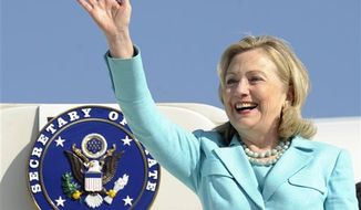 ** FILE ** In this June 10, 2011 photo, Secretary of State Hillary Rodham Clinton waves as the arrives at Lusaka International Airport in Lusaka, Zambia. Clinton has been admitted to a New York hospital after the discovery of a blood clot stemming from the concussion she sustained earlier this month. Spokesman Philippe Reines says her doctors discovered the clot during a follow-up exam Sunday, Dec. 30, 2012. (AP Photo/Susan Walsh, Pool)