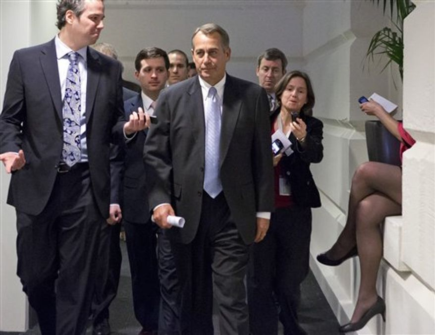 Reporters pursue Speaker of the House John A. Boehner, Ohio Republican, as he walks to a closed-door meeting with GOP members of the House as Congress in Washington, Monday, Dec. 31, 2012, as Senate and House leaders rush to assemble a last-ditch agreement to head off the automatic tax hikes and spending cuts set to take effect Jan. 1, 2013. (AP Photo/J. Scott Applewhite)