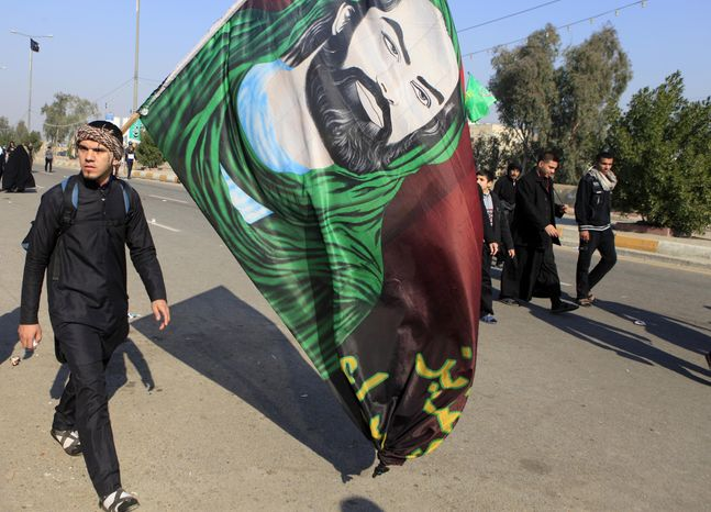 Shiite pilgrims march on their way to Karbala for Arbaeen in Baghdad on Dec. 31, 2012. Each year, hundreds of thousands converge on the southern city of Karbala to mark the end of the forty day mourning period following the anniversary of the 7th-century death of the Prophet Muhammad's grandson, Imam Hussein. Many pilgrims travel on foot and the mass gatherings are frequently attacked despite tight security. (Associated Press)